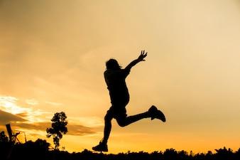 Fitness silhueta amanhecer jogging exercício conceito de bem-estar