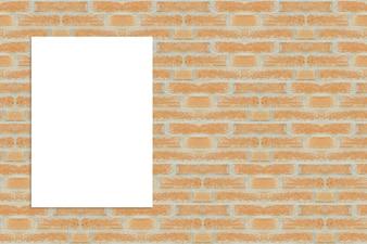 Folha em branco na parede de tijolo
