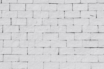 Fundo abstrato da parede de tijolos brancos