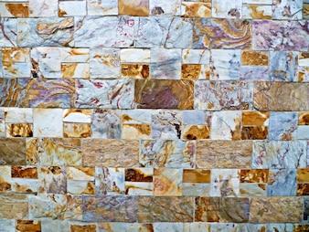 Fundo de parede com inlays de tableta de várias texturas