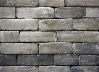 Fundo de textura da parede de tijolos cinza
