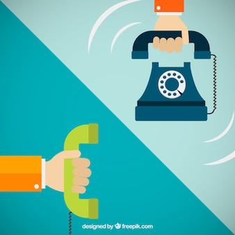 Mãos segurando telefones