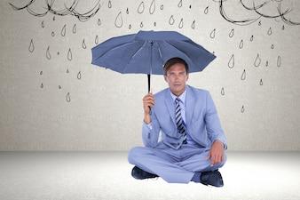 Homem de terno e um guarda-chuva