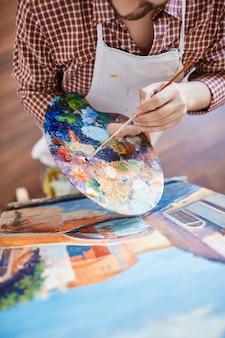 Idéia mão pintura closeup arte