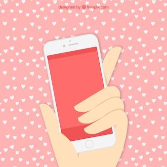 mão com telefone celular