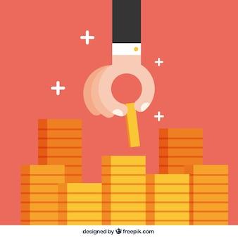 Mão que põr a moeda na pilha de moedas