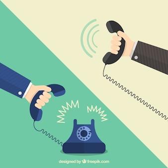 Mãos que prendem telefones