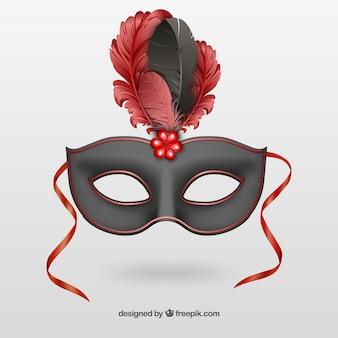 Máscara preta do carnaval com penas vermelhas