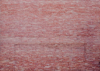 Parede de tijolo vermelho surpreendente e enorme