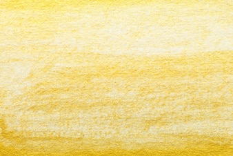 Pintura de aquarela abstrata de ouro amarelo, texturizada no fundo de papel branco