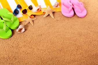 Praia com flip-flops