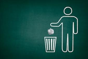 Quadro-negro com um caractere usando uma lata de lixo