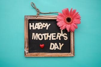 Quadro-negro do dia das mães com flor