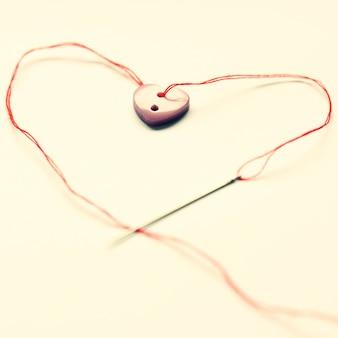 """""""Botão em forma de coração e precisa"""""""