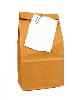 Saco de papel do almoço de Brown com uma nota