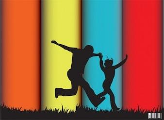 Silhuetas de pessoas pulando em grande colorido listrado