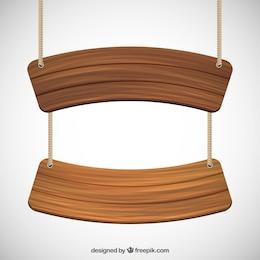 Sinais de madeira pendurado em uma corda