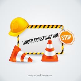 Sob o sinal da construção com cones de trânsito