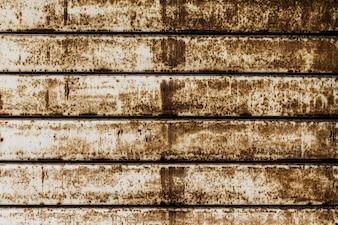 Textura bonita da parede oxidada das listras do Grunge. Horizontal. Padronizar. Fundo Oxidado.