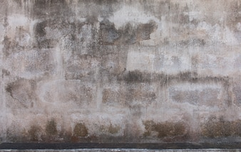 Textura do muro de concreto antigo para o fundo