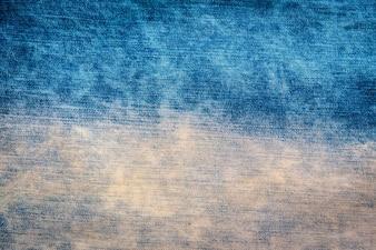 Textura velha das calças de brim