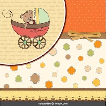 Urso de peluche no cartão de carrinho de bebê