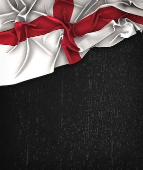 Vintage da bandeira de Inglaterra em um quadro preto do Grunge com espaço para o texto