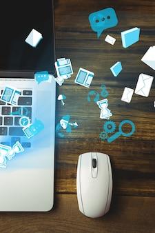 Vista superior do portátil e rato com ícones da tecnologia