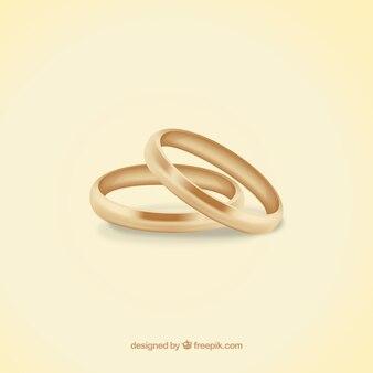 Os anéis de casamento feito de ouro