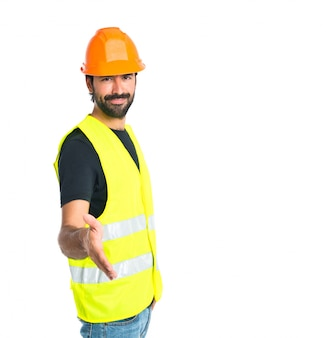 Arbeiter machen einen Deal über isolierten weißen Hintergrund