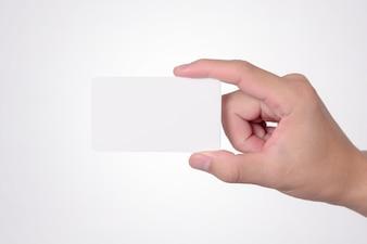 Blank Visitenkarte Mock up in Hand auf blurre Büro Schreibtisch Hintergrund verwenden Sie uns Kontakt Informationen Design Tempel