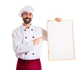 Chef hält leeres Plakat