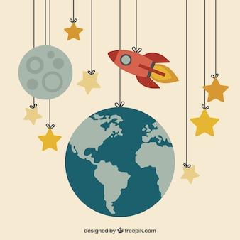 Erde, Mond und eine Rakete hängen in den Seilen