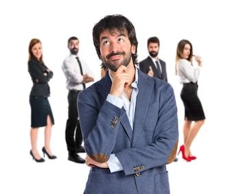 Geschäftsmann Denken über isolierten weißen Hintergrund