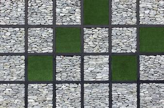 Grüne Gras und Steinmauer Textur Hintergrund