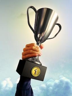 Hand hält einen Sieger Cup