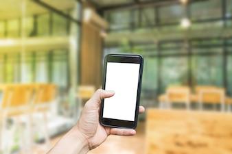 Hand hält Telefon mit Hintergrund