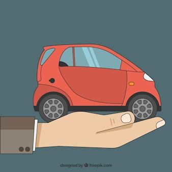 Hand mit einem Auto