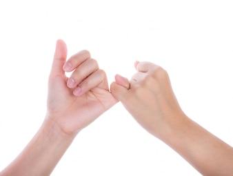 Hände Dicht ein Versprechen mit den kleinen Finger