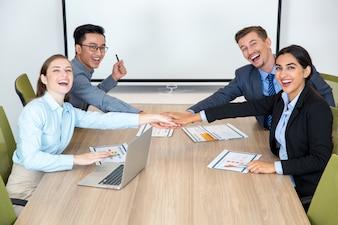 Joyful Business Team Joining Hands Together