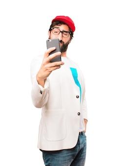 Junge verrückte Geschäftsmann mit einem Handy