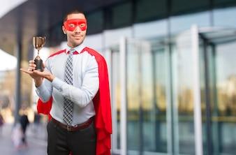 Konzept eines Gewinner Super Geschäftsmann mit einem Gold Cup