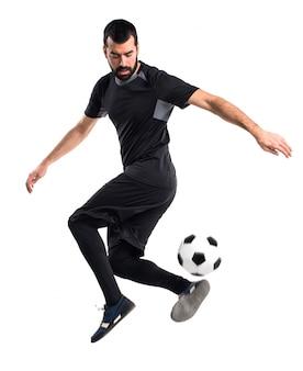 Mann spielt Fußball
