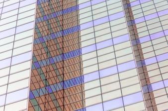 Moderne städtische Hochhäuser, Glas Vorhangfassade, regelmäßiger Hintergrund