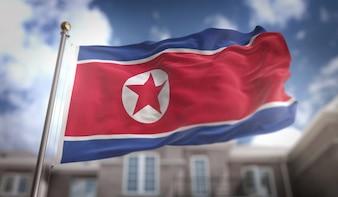 Nordkorea Flagge 3D Rendering auf blauem Himmel Gebäude Hintergrund