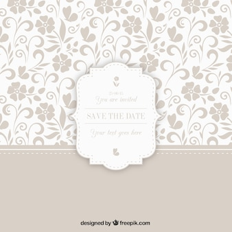 Ornamentales Muster mit Hochzeitsabzeichen