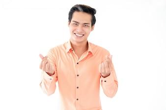 Positive asiatische Mann zeigt Geste für Geld
