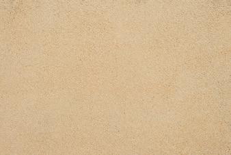 Sand Textur. Brauner Sand Hintergrund aus feinem Sand Sand Hintergrund.