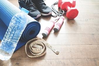 Sportausrüstung auf Holzboden, Ausarbeitung von Konzept