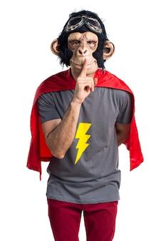 Superheld-Affe Mann macht Stille Geste